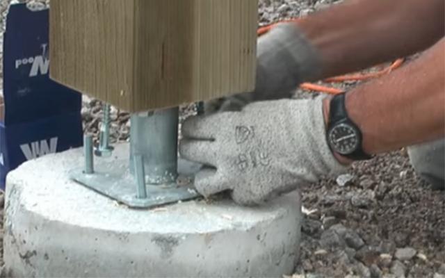 Placement du poteau sur la dalle